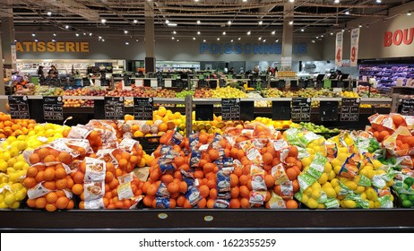 21 January 2020, Strasbourg - France:  Fresh fruit and vegetable aisles, apples, tangerines, oranges and other fruits can be bought fresh at the supermarket.