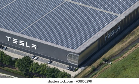21 July 2017, Tilburg, Holland. Aerial view of Tesla Motors assembly car factory. The roof is full with solarpanels.