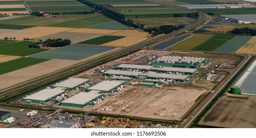 21 July 2018, Middenmeer, The Netherlands. Aerial view of a construction site for a new datacenter for Microsoft. The huge building is located along highway A7 in the province NOORD HOLLAND.