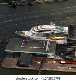 21 June 2018, Amsterdam, Holland. Aerial bird view of large cruise ship behind the concert hall Muziekgebouw in the port of Amsterdam.