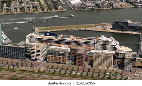 21 June 2018, Amsterdam, Holland. Aerial bird view of large cruise ship MSC for Unicef in the port of Amsterdam behind some highrise buildings.