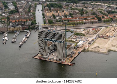 21 June 2018, Amsterdam, Holland. Aerial bird view of new Dutch landmark. The Ponsteiger residential building in the Houthaven. Still under construction but nearly finsihed.