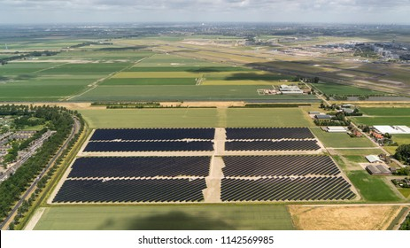 21 June 2018, Hoofddorp, Holland. Aerial bird view of solarpark de Groene Hoek, located between Schiphol Airport and Hoofddorp. The photovoltaic powerstation supplies the city with green energy.