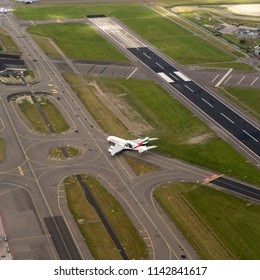 21 June 2018, Hoofddorp, Holland. Aerial bird view of a Emirates Airbus A380 on the taxi way at Schiphol Amsterdam Airport.
