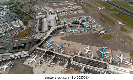 21 June 2018, Hoofddorp, Netherlands. Aerial bird view of Schiphol Amsterdam Airport on a cloudy day. A lot of KLM jets are parked at the gate.