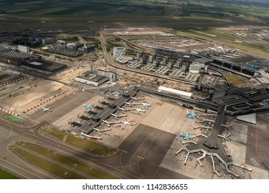21 June 2018, Hoofddorp, Netherlands. Aerial bird view of Schiphol Amsterdam Airport on a cloudy day. The airport is a big construction site due to expansion.