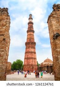 21 JUNE 2018, NEW DELHI - INDIA. Tourist visit Qutub Minar, the tallest minaret in the world in New Delhi, India