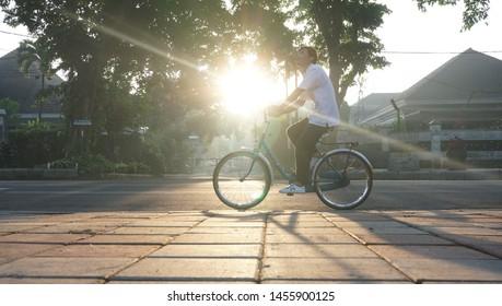 21 November 2016 - cfd Malang city, Indonesia. cyclists enjoy a morning tour around cfd Malang city