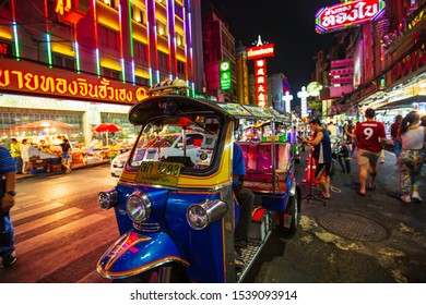 21 October,2019 Bangkok, Thailand Famous moto-taxi called tuk-tuk is a landmark of the city and popular transport, Tuk tuk on the street in Chinatown, street food night market in bangkok thailand.