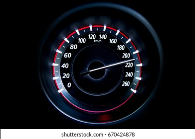 210 Kilometers per hour,light with car mileage with black background,number of speed,Odometer of car