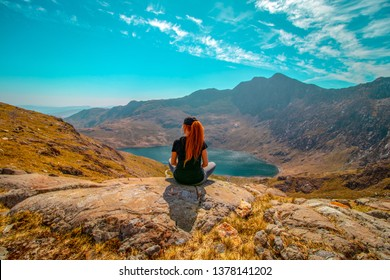 21/04/2019 Snowdonia, Wales .People Hiking and looking across beautiful Snowdon  mountain landscape. Snowdon mountain is located in Snowdonia National Park,Wales ,United Kingdom.
