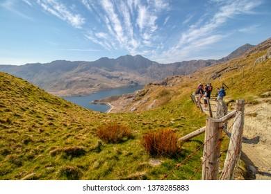 21/04/2019 Snowdonia , Wales,UK. Tourist admiring beautiful Snowdonia Landscape . The route to the Mount Snowdon.