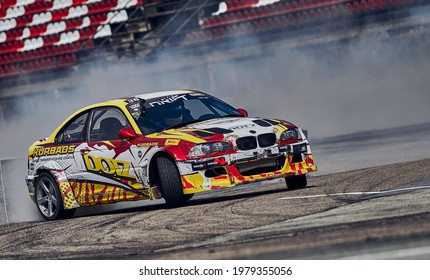 21-05-2021 Riga, Latvia car drifting on asphalt racing track with lot of smoke, motion blur drift car..