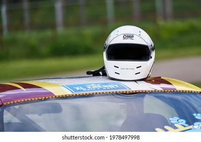 21-05-2021 Riga, Latvia racing helmet on top of a racing car.