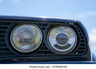 21-05-2021 Riga, LAtvia Round headlight on a old BMW car.