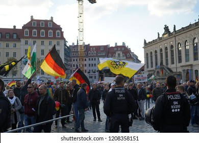 21/10/2018 DRESDEN, Germany - followers of the right-wing Pegida movement demonstrate on the fourth anniversary in front of the Frauenkirche.