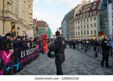 21/10/2018 DRESDEN, Germany - Opponents and followers of the right-wing Pegida movement demonstrate on the fourth anniversary in front of the Frauenkirche.