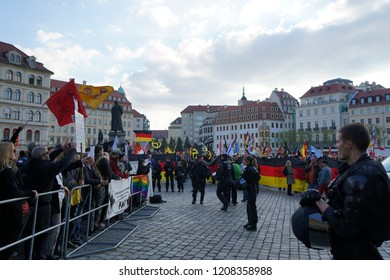 21/10/2018 DRESDEN, Germany - Opponents (left) and followers (right) of the right-wing Pegida movement demonstrate on the fourth anniversary in front of the Frauenkirche.