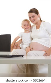 21-30 years pretty pregnant mother with her child sitting in front of a laptop