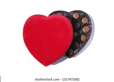 """2-16-2019: Lake Forest California.  Pangburns of Texas """"Millionaires"""" Valentines Day Heart shaped box of Pecans and Honey Caramel covered in Milk Chocolate. Isolated on white. Room for text."""