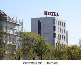 21st of April 2019 - Cityscape with view past tree tops to a hotel, Aalborg, Denmark