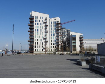 21st of April 2019 - Scene from a Danish port with view to residential buildings against a blue sky, Aalborg, Denmark
