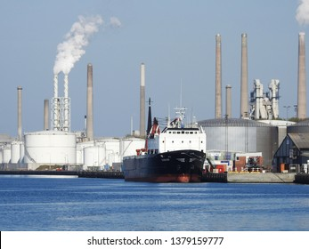 21st of April 2019 - Scene from a Danish port with view to a vessel in front of an industrial skyline, Aalborg, Denmark