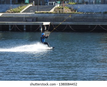 21st of April 2019 - Scene from Danish harbor wit view to guy doing water sports, Aalborg, Denmark