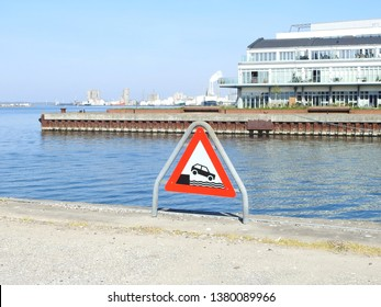 21st of April 2019 - Scene from a danish port with warning sign on the  quay, Aalborg, Denmark