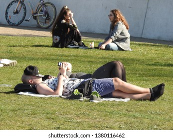 21st of April 2019 - Scene from a Danish park with people relaxing on the grass, Aalborg, Denmark
