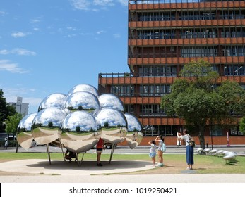 21st August 2017, at 21st Century Contemporary art musuem , Kanazawa, Japan. a women and her children enjoy the amazing silver bubble in the park behind museum.