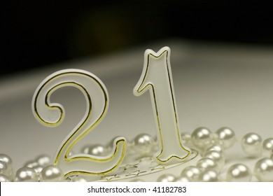 21st birthday sign surrounded by pearls, a celebratory concept