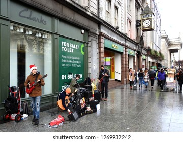 21st December 2018, Dublin. Busking band on O'Connell Street during the Christmas period.