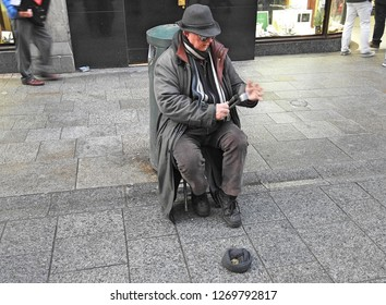21st December 2018, Dublin. Man busking on Grafton Street with spoons during Christmas period. Spoons are blurred due to the speed of clicking.