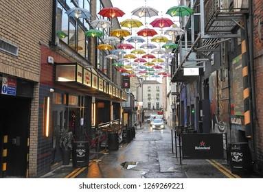 21st December 2018, Dublin. Side Street off Grafton Street called Anne's Lane with an umbrella street display.