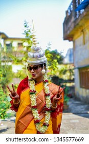 21st January 2019, Kolkata : Bengali Bride wearing yellow saree and garland on her wedding day . Bride also wearing Sunglass and making a Victory sign as she won the game of love and going to marry .