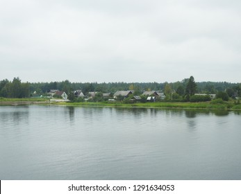 21st of July 2018 - Scene from Russian riverside with view past the water to traditional wooden houses, Ust-Luga, Russia