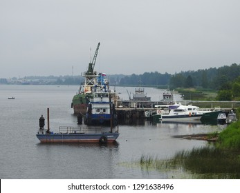 21st of July 2018 - Scene from Russian riverside with view to a group of vessels, Ust-Luga, Russia