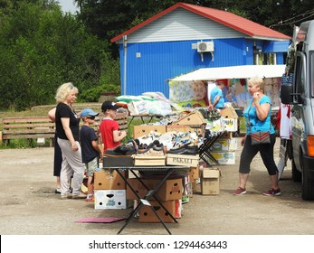 21st of July 2018 - Scene from Russian city with group of people at a market stall, Ust-Luga, Russia