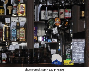 21st of July 2018 - Scene from Russian bar with close up counter with a beer dispenser against a blurred background with bottles, Ust-Luga, Russia