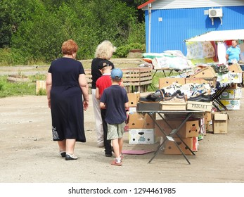 21st of July Scene from a Russian city with group of people in front of a market stall, Ust-Luga, Russia