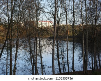 21st of October 2017 - Sene from Russian city with view to residential buildings past trees and the Luga River, Kingisepp, Russia