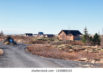 22 April 2018: Grimsnes, South Iceland - Icelandic summerhouses on a clear morning.