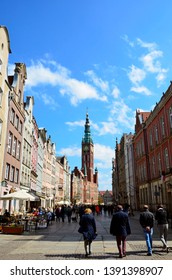 22 April 2019, Gdańsk, Poland. View of the Town Hall and tenement houses. Walk on Długa Street on a beautiful sunny day.