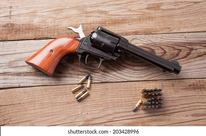 A 22 caliber revolver with bullets.