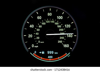 220 Kilometers per hour,light with car mileage with black background,number of speed,Odometer of car.