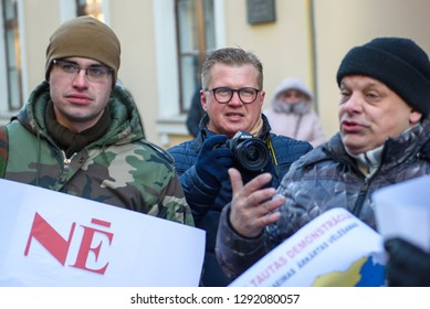 22.01.2019. RIGA, LATVIA. Selective focus photo.  Ansis Pupols, journalist (C), during  Demonstration against new coalition of government of Latvia outside Saeima building (Parliament of Latvia).