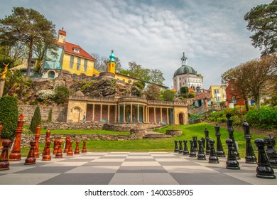 22/04/2019 Portmeirion, North Wales UK. Chess on Chessboard  and beautiful  Portmeirion  village in the background . Portmeirion  is a tourist village in Gwynedd  North Wales.