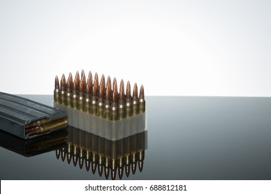 .223 5.56 semi automatic AR15 assault ammo on reflective surface white background