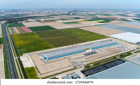 23 April 2020, Middenmeer, Holland.   Aerial view of new Google and Netflix datacenter HPE Nimble. The huge building is located in a agricultural environment with flower tulip fields and greenhouses.